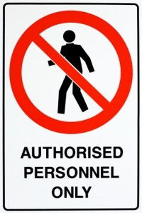 A white, red, and black authorized personnel only sign